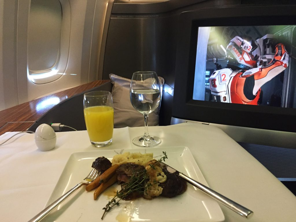 Cathay Pacific meal service in First Class