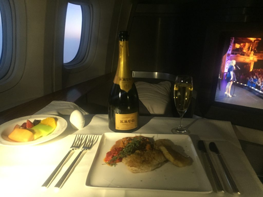 Bottle of Krug during meal service on Cathay Pacific